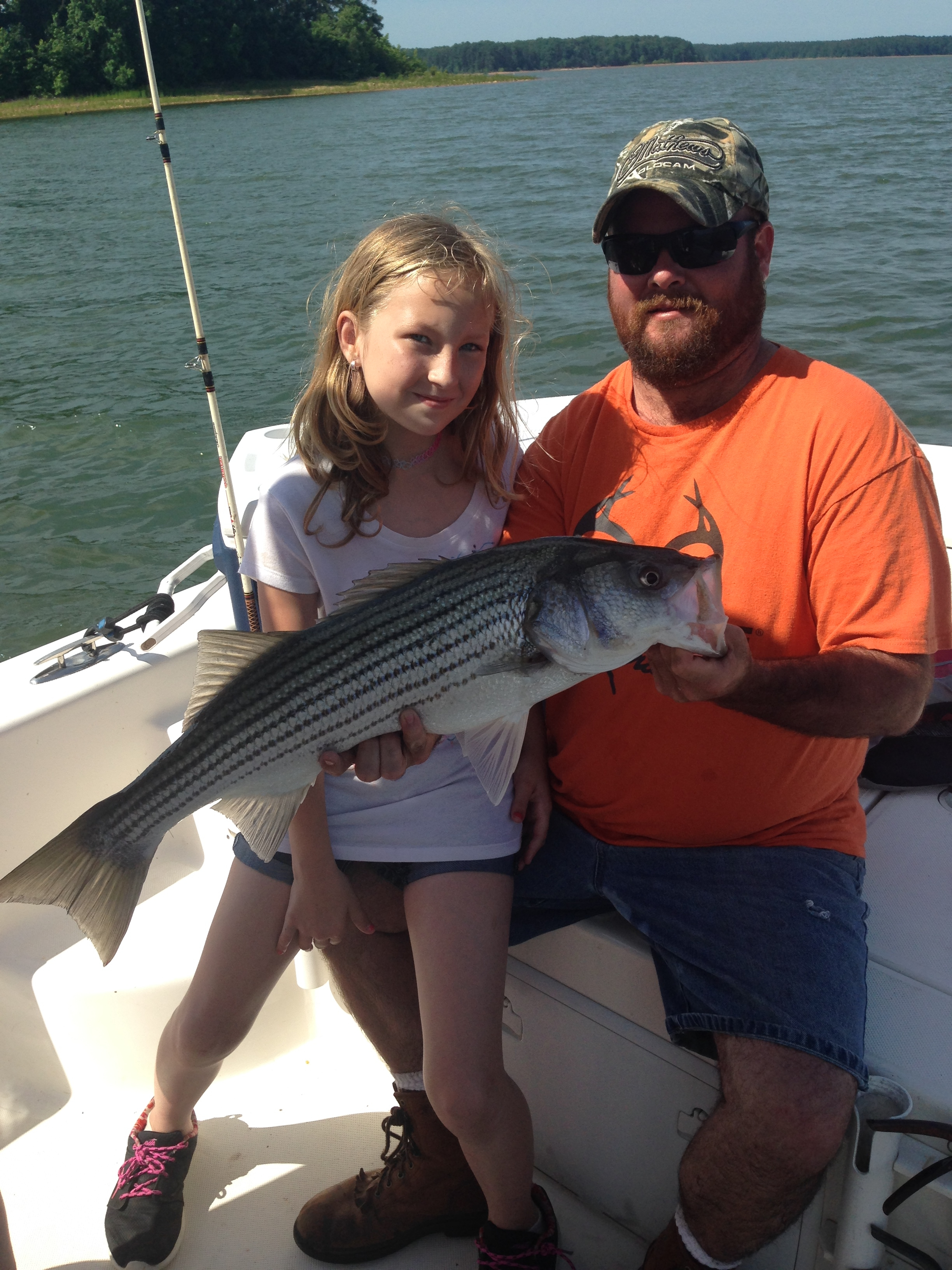 May 29,2017 Tiffant Barrow with her 15 pound striper Brad helping hold the striper.