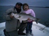 Abby and dad with her 15 pound striper.