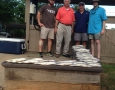 Brandon Poole, Bob Evans and Brent Lake with their 40 stripers and hybrid
