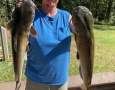 July 11, 2018 Bryan Kalsek with her two big catfish. IMG_2263