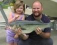 Abby and her dad, Brad, with her 15 lb striper
