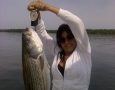Kelli Bennett with her 21 pound striper