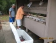 Billy and Larry cleaning fish.J une 2011
