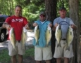 Jeremy Murray, Ricky Peace and Jim Murphy holding 6 of 40 stripers they caught.