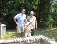 Frank Toole, Dr. Jon Spiers and Jon Phillip Spiers with 17 stripers they caught.