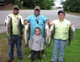 Brad, Johnathan, Jim, and James with six of the 40 stripers they caught. They were 6-15lbs.