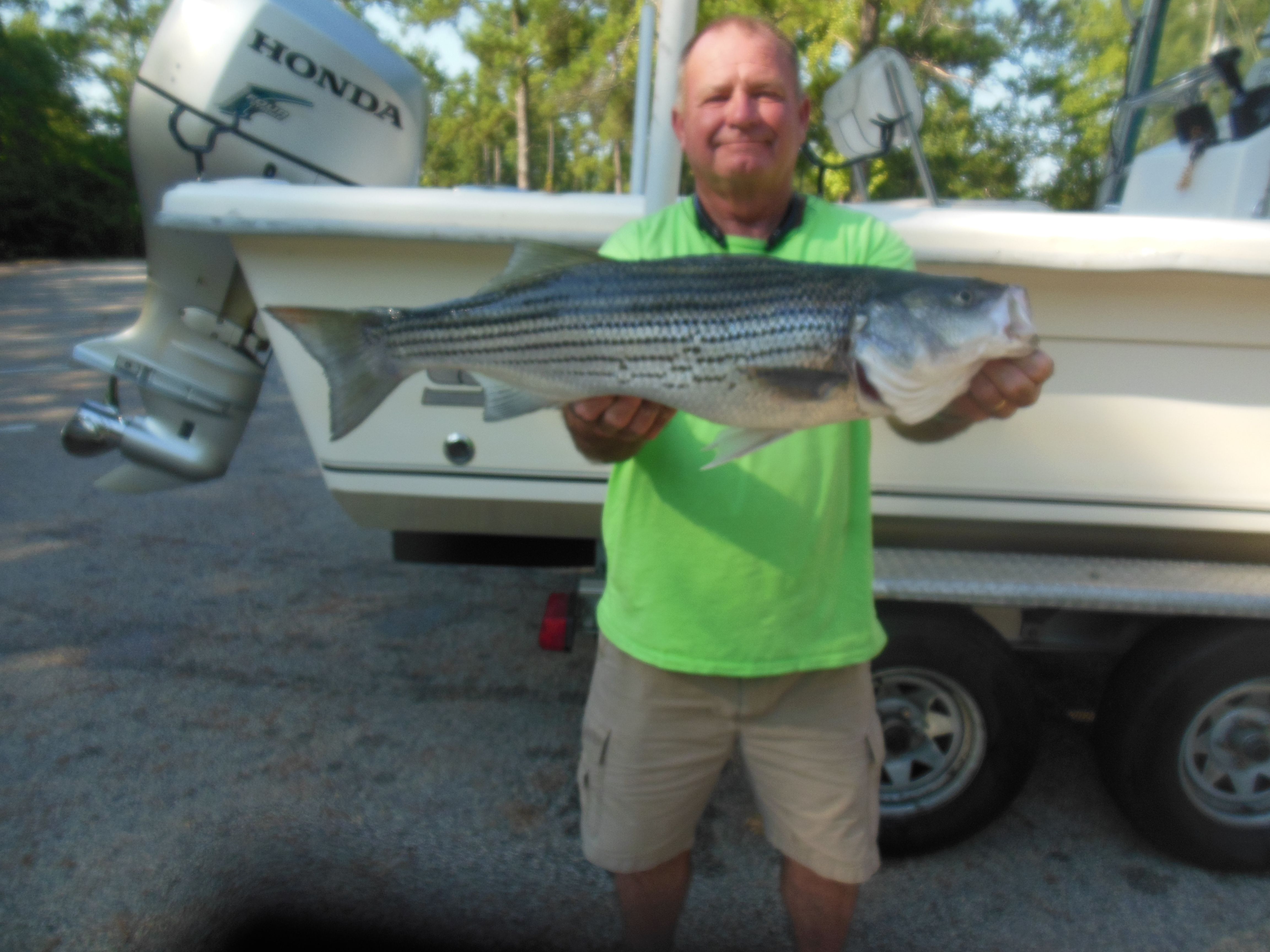 Captain Billy with 10 lb striper July 25, 2016
