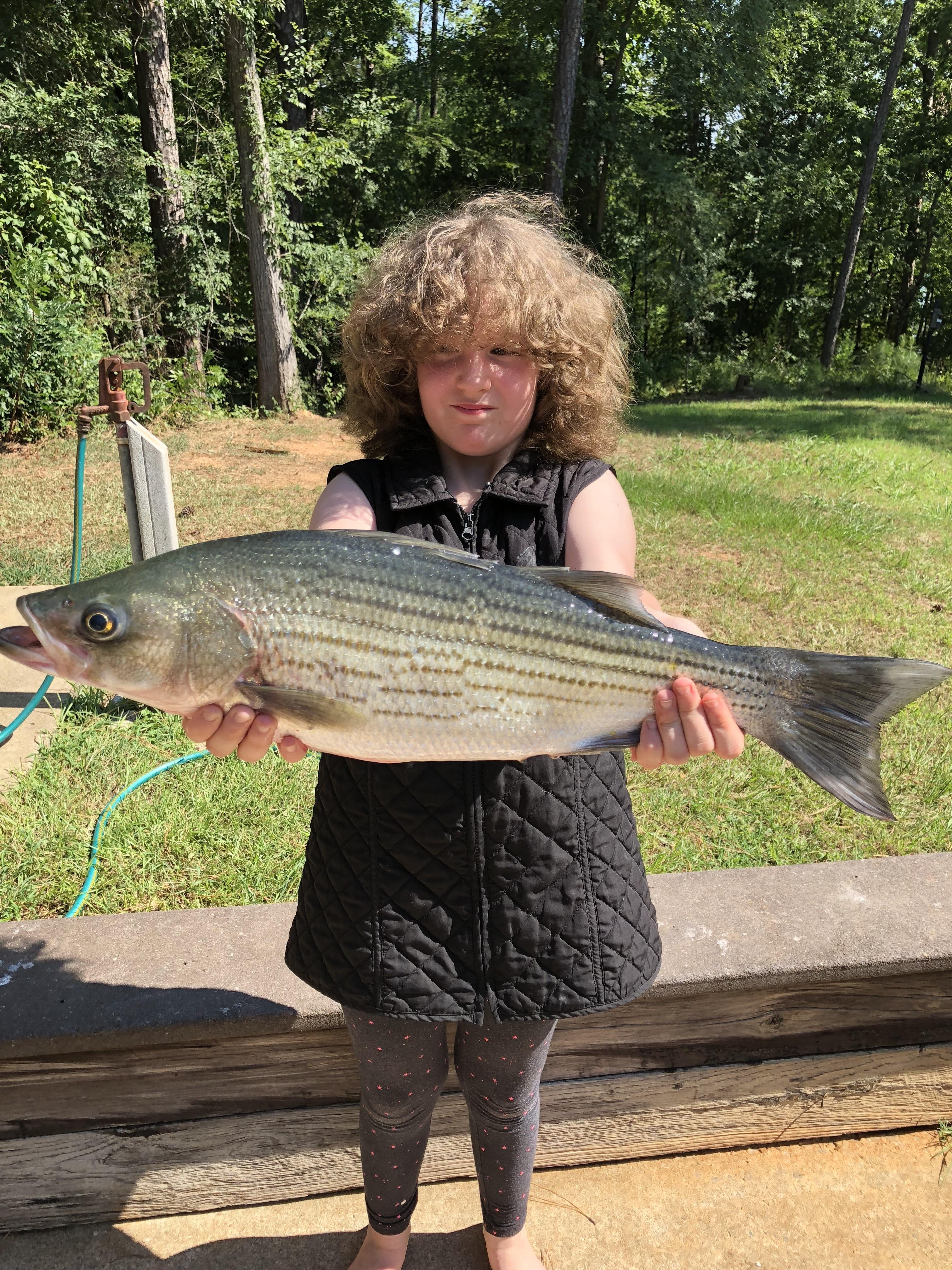July 11, 2018, 9 year old Sara Kalsek with her big hybrid. IMG_2260