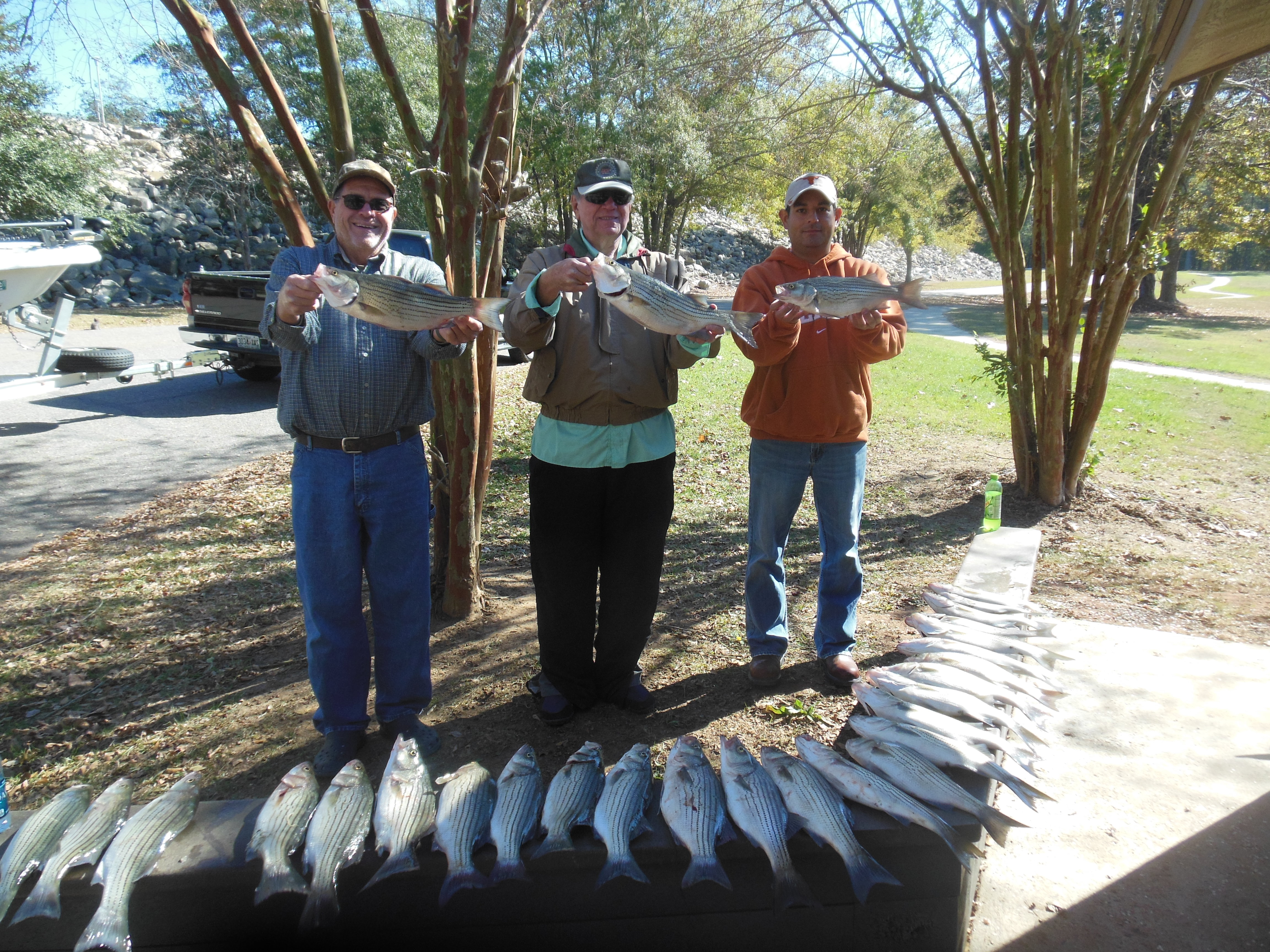 Ronnie, Raymond Walker and Robert Robinson with limit of stripers and hybrids.