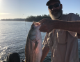 Oct.-12-2019JP-Rosamond-with-his-15-pound-striper.-Caught-on-Mini-Mack-Rigs